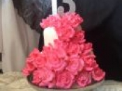 13th cake pink flower covering