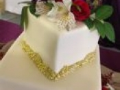 2 tier white gold trim cake