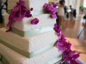 5 tier wedding cake purple flowers close up