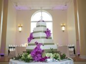 5 tier wedding cake purple flowers with background