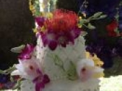top of tier cake multicolor flowers