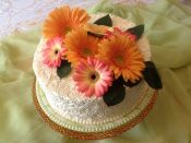 white cake orange pink flowers
